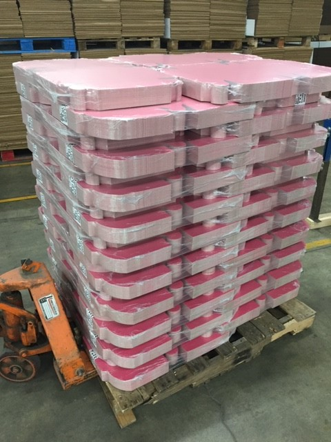 skid of stacked cake boxes